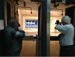 Tow men shooting air pistol silhouettes