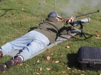 Man shooting black powder rifle
